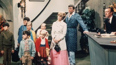 Florence Henderson with her on-screen family in <i>The Brady Bunch.</i>