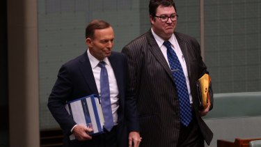 National MP George Christensen, pictured with Prime Minister Tony Abbott, has charged taxpayers for books on climate-change denialism.