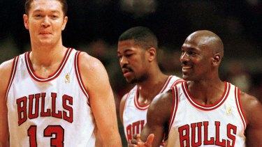 Big man: Luc Longley with Michael Jordan.