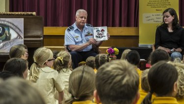 Teen author Jessica Love and Chief of Defence Force Air Chief Marshal Mark Binskin read Soon to pupils at Campbell Primary School.