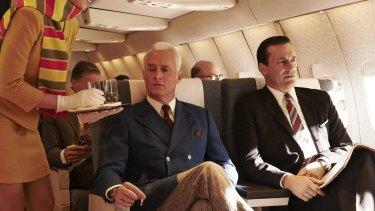 Jon Hamm, right, as Don Draper, with John Slattery, as Roger Sterling, flying high in Season 7 of Mad Men.