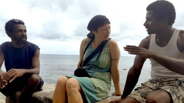 Writer Janet Galbraith talks to islanders in a scene from the film