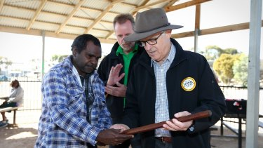 Prime Minister Malcolm Turnbull and Indigenous Affairs Minister Nigel Scullion receive gifts after a visit to the Yalata Anangu School  in South Australia.