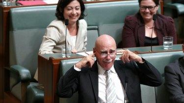 Labor MP Terri Butler's interjection surprises Warren Snowdon during question time.