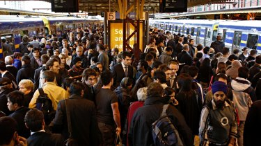 Trains that could ease the peak-hour crush are sitting idle.