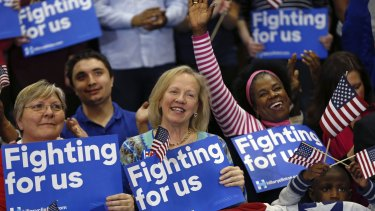 Supporters of Hillary Clinton cheer her victory.