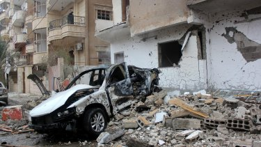 """The wreckage of a car following an alleged Syrian regime air strike on Raqqa, the headquarters of the so-called Islamic State's """"caliphate""""."""