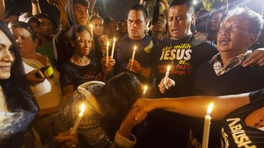 A midnight candlelight vigil held in Cilacap.