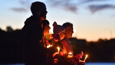 People pay their respect to Justine Damond at Freshwater Beach during a vigil on Wednesday.