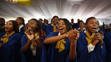 The choir sings at the student graduation ceremony attended by Zimbabwean President Robert Mugabe.