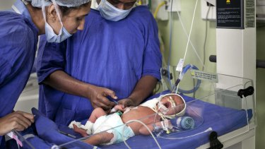 A newborn baby at the Akanksha Clinic, in Anand, India which has now outlawed commercial surrogacy.