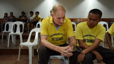 Peter Scully inside the Cagayan De Oro court handcuffed to another inmate on his first day of his trial in 2016.