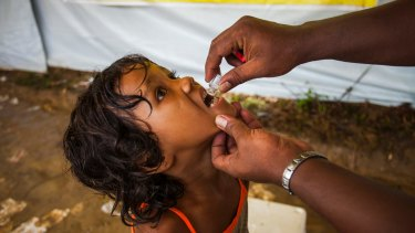 A Rohingya girl is administered cholera vaccine at the Balukhali makeshift camp in Cox's Bazar, Bangladesh.