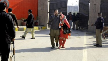 University staff leave the campus in Charsadda, Pakistan, after the attack on Wednesday.