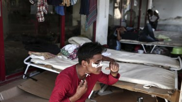 A migrant shaves himself inside an abandoned hotel where dozens of migrants have been living the last weeks at Kos town, Greece.