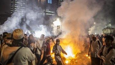 Muslim demonstrators march in Central Jakarta on November 4.