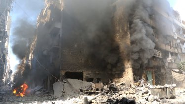 Smoke rises from an Aleppo building after an air strike last month.