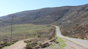 A road through the hills of the Israeli-occupied West Bank, near one of the outposts raided by security forces investigating the attack on the Dawabshe family.
