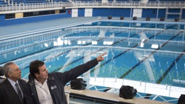 Brazil's interim President Michel Temer, left, talks to Rio de Janeiro Mayor Eduardo Paes at the Olympic Aquatics Stadium. Mr Temer says all venues are ready.