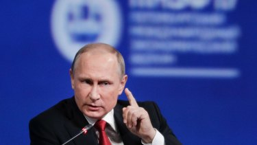 Russian President Vladimir Putin gsays the chemical attack in Syria was provocation to frame Syrian President Bashar al-Assad.