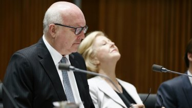 Attorney-General Senator George Brandis and Australian Human Rights Commission President Professor Gillian Triggs during a Senate estimates hearing at Parliament House in Canberra on Tuesday.