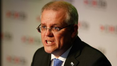 """Treasurer Scott Morrison says the mandated credit reporting regime will be a """"game changer."""""""