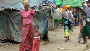 Four-year-old Rosmaida Bibi walks with the help of her mother  at the Dar Paing camp for Rohngyas in Rakhine State.