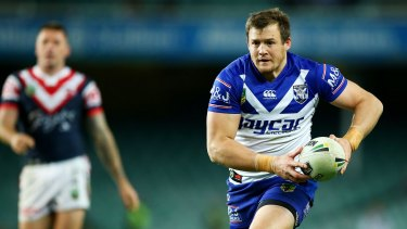Twin tormentors: Josh Morris runs the ball during the round 17 NRL match between the Sydney Roosters and the Canterbury Bulldogs at Allianz Stadium.