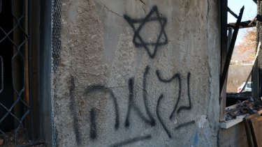 "Hebrew graffiti - ""Revenge"" - sprayed on the wall of the Dawabshe family home."