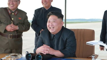 North Korean leader Kim Jong-un attends what was said to be the test launch of an intermediate range missile on September 16.