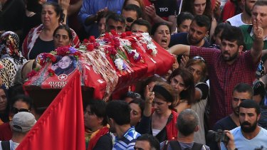 Mourners carry the coffin of Duygu Tuna, one of the victims of the explosion on Monday in the town of Suruc, Turkey.