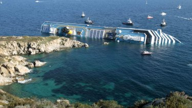 January 2012: the luxury cruise ship Costa Concordia leans on its side after running aground on the tiny Tuscan island of Giglio. Thirty-two people died in the accident.