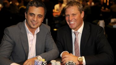 Shane Warne and Joe Hachem at a charity poker tournament.