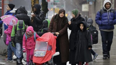 Muslim women with their children in Brooklyn on Wednesday. New York City mayor Bill de Blasio announced that schools will close for the Islamic holiday of Eid al-Adha for the first time in September.