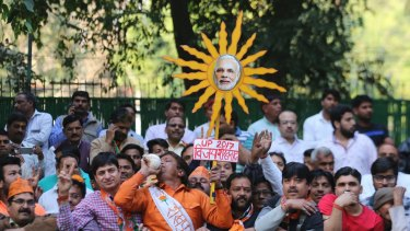 Narendra Modi (depicted here as the sun) promised to govern for all Indians. But the appointment of Yogi Adityanath has cast a shadow over those words.