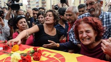 Family members of Korkmaz Tedik, a victim of the October 10 attack, mourn in Ankara.