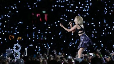 Ocean of blue light: Taylor Swift performs during her 1989 World Tour.
