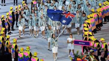 Australia flag bearer Anna Meares leads the team into the stadium.