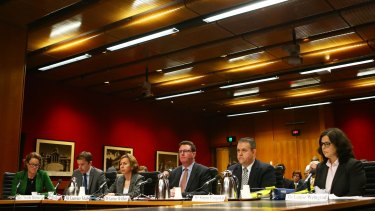 Representatives of big pharmaceutical companies attend the Senate inquiry into corporate tax avoidance last year.