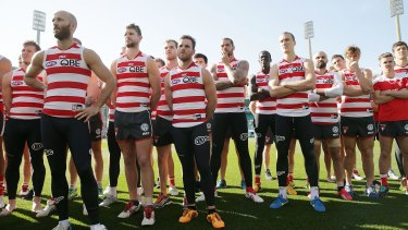 Show of unity: Sydney players stand in solidarity for teammate Adam Goodes.