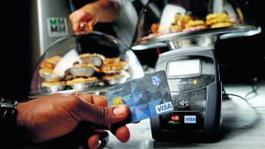 A customer pays by Visa payWave. Contactless payment systems have become popular in an increasingly cashless society.