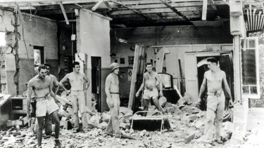 A house is destroyed after being hit by a Japanese bomb during an attack on Darwin in 1942.
