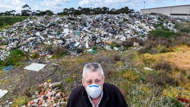 Bill Patten on land he leased to a Melbourne company he says dumped asbestos-riddled rubbish and walked away.