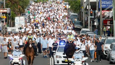 Huge crowds turn out for the White Ribbon Walk at Coogee on Tuesday morning.