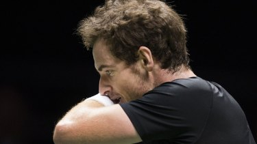 Andy Murray feels the pain after losing to Gilles Simon in Rotterdam.