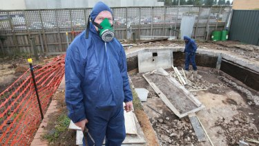 Andrew Morrison, and a colleague removing asbestos linings from an old in-ground pool.