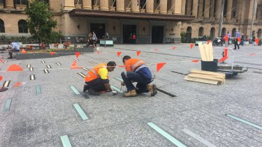 A team of two council workers remove the lights on May 9.