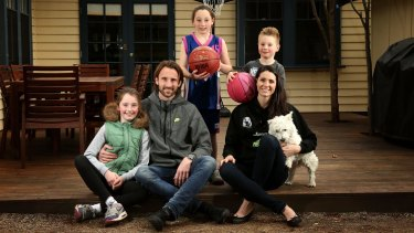 Returning WNBL basketballer Jacinta Kennedy with her husband Josh Kennedy, a retired Socceroo, their three children, Jada , Isabelle and Lachie, and dog Ned.