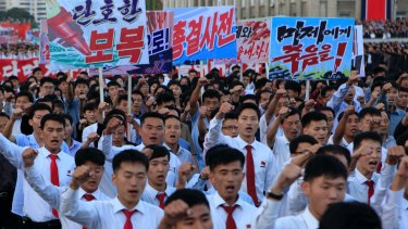 North Koreans gather at Kim Il Sung Square to attend a recent mass rally against America.