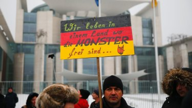 "The 'International Convention of German Russians' protest against sexual assaults by migrants in Berlin. The sign reads ""We live in a country where monsters are free"".  The girl whose claims sparked this protest later admitted fabricating her story of rape by Middle Eastern-looking men."
